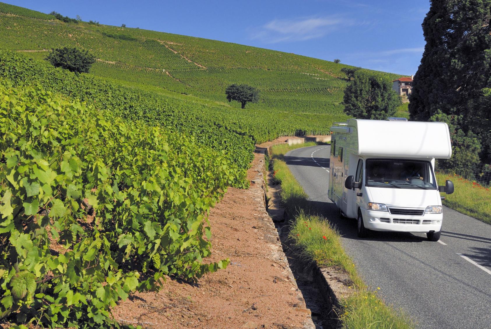 Caravan on its way in France between the vineyards in Beaujolais